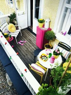 get rid of the balcony tin roof for sure - wood floors?  Also like this as reminder of goal = outdoor room and gardening space for Tim