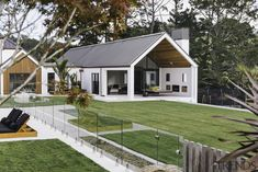 White plaster is contrasted with Western red cedar accents in the cladding for this home. Architecture Durable, Modern Barn House, Gable Roof, Gable House, Cladding, Bauhaus, Exterior Design, Future House, House Plans