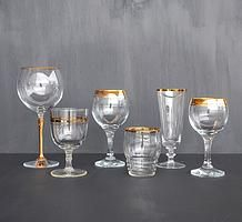 Gold rimmed wine glasses and goblets for hire for weddings and events