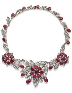 AN ANTIQUE RUBY AND DIAMOND NECKLACE, 1890S. The oval-cut ruby and old-cut diamond flowerhead front panel with diamond-set leaves with similarly-set side designs, to the necklace composed of a series of alternating diamond-set leaves and oval-cut ruby collets, with additional fittings to wear as a bracelet and brooches. #antique #necklace