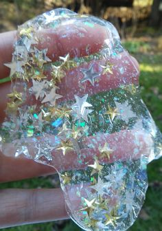 This winter star glitter slime has a great sparkle. This shimmery Christmas slime features clear slime and metallic stars in silver and gold and iridescent snow. It is magical and amazing to see in the light. This holiday slime is soft and great for sensory therapy, stress relief, and