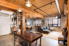 Broadview Lofts - #201 | Toronto LOFTS Exposed Brick Walls, Exposed Concrete, Concrete Floors, Foyer Storage, Toronto Lofts, Lofts For Rent, Fire Doors, Closet Shelves, Post And Beam