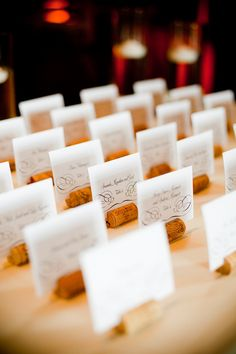 diy cork escort cards for guests at wedding reception #escortcards #diy #weddingchicks http://www.weddingchicks.com/2014/01/30/pink-and-peach-bejeweled-wedding/