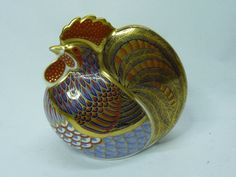 A Royal Crown Derby Cockerel paperweight, with gold stopper  Sold For: £60