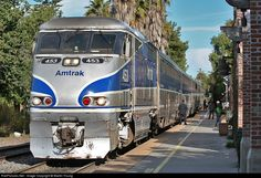 A San Diego-bound Pacific Surfliner makes a brief stop at the station, across the street from the SJC mission.