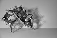 Tensile Membrane / Surface Exploration art sculpture using metal and mixed media looks like people dancing in a ring