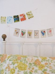 Cute garland...rectangles made from old book pages, stitched around, then added a heart shape from a patterned paper.