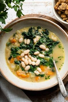 White Bean Soup with Kale is nourishing, comforting, and simple to make with canned Great Northern beans, nutritious kale, spinach, and pantry-friendly ingredients! Kale And Bean Soup, Soup Beans, White Bean Soup, White Beans, Bean Soup Recipes, Vegetarian Recipes, Healthy Recipes, Healthy Eats, Kale Recipes
