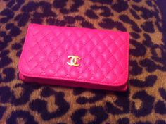 pink Chanel quilted clutch