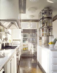 "Galley kitchen. I'd love to have clear cabinets like this with that kind of organization. It brings such a feeling of ""clean"" to the space."