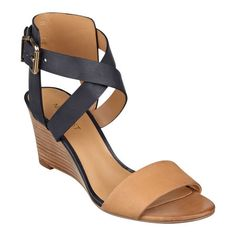 "We think you'll love our Nofrills streamlined crisscross strap wedge sandals. These open toe sandals feature a chic band across the vamp. Adjustable buckle closure. Padded footbed for all-day comfort. Leather upper. Man-made lining and sole. Imported. 2 3/4"" mid heels. Sandals for women."