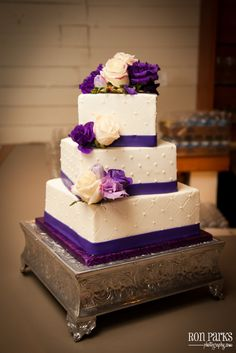 Offset square cake, purples & blues would look fab. Sugar flowers not real.