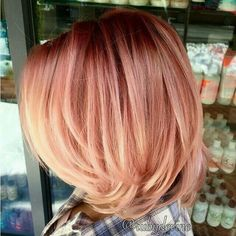 Pink hair with blond ombre on the bottom