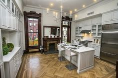 Excellent retention of historic architectural shell whilst modernizing the kitchen | parquet flooring - white cabinetry - wood casings - white countertops | Hancock Street Brooklyn brownstone Victorian kitchen | by techpro12