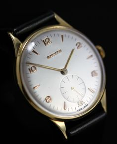 1955 Vintage Zenith 18K Gold Watch. Hands and markers are Rose gold. Beautiful.