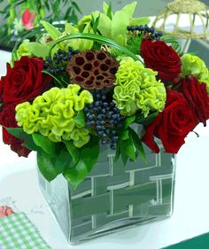 In this vase arrangement it is showing the colours Red, Blue-Green and Yellow-Green this is called SPLiT complementary arrangement
