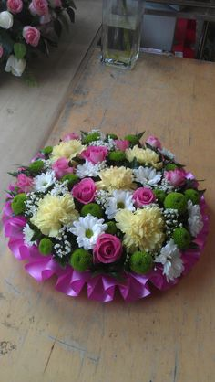 variety of Chrysanthemums and Roses used for the tribute