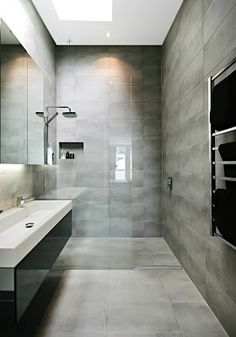 Wet room with linear drain.   The drain in this room is positioned interestingly, separating the wet and dry areas.