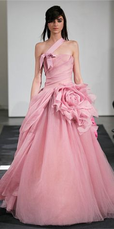 VERA WANG FALL 2014:  Petal strapless silk organza ball gown with hand draped bodice accented by organic flower, grosgrain shoulder strap and peony fail...