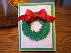 Wreath card using holly punch for greenery.I used the Dotted Swiss emboss folder to emboss with Cuttlebug. Simple and sweet.