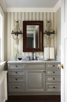 bathrooms - Para Paints - Peaks and Valleys - Farrow & Ball Block Print Wallpaper ivory gray silver striped wallpaper pale blue ceiling glossy gray bathroom vanity marble top wood beveled mirror flanked iron white beaded sconces