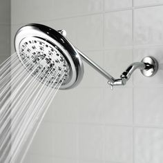 The Pressure Boosting Rainfall Showerhead - Hammacher Schlemmer - Boosts the pressure of water passing through it by 30% more than traditional models.