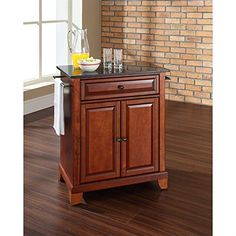 Special Offers - Crosley Furniture Newport Solid Black Granite Top Portable Kitchen Island in Classic Cherry Finish - In stock & Free Shipping. You can save more money! Check It (April 02 2016 at 10:51AM) >> http://storagecabinetusa.net/crosley-furniture-newport-solid-black-granite-top-portable-kitchen-island-in-classic-cherry-finish/
