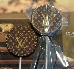 12 Louis Vuitton chocolates Can also be a lollipop or cupcake toppers. $24.00, via Etsy.