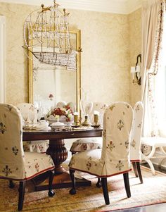 Atelier Branca designed the ebonized ball-and-claw dining chairs slipcovered in Nobilis embroidered linen. The giltwood mirror is Louis XVI and the droll bronze and crystal chandelier is vintage. The Chadwick walnut dining table was found at Emanuel Morez, and sconces at John Rosselli.