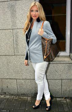 Caprice Bourret.. business chic with a Louis Vuitton shoulder bag - elegant maternity fashion..