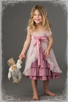 fancy little girl dress. I love the overlay and the ruffles peeking out.