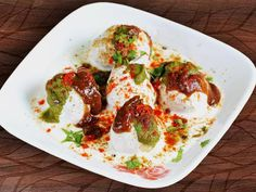 Dahi Bhalla or Dahi Vada is a delicious Indian street food especially in North India. The dish is so popular that it does not require any introduction and is so soft and delicious that no one will refuse to eat. Dahi Bhalla is not only soft and delicious dish but the recipe of dahi bhalla is very easy to make. #dahi #bhalla #dahibhalla #curd #vegetarian #dahibhallarecipe #chaat #streetfood #streetfoodchaat