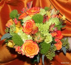 Here is an example of a bridal bouquet with two toned roses, succulents, yellow calla lilies and green roses. This bouquet is perfect for a summer or fall wedding!