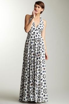This is the style I was just saying--for a casual event.  Not sure how you feel about the arms, but I think you would look nice in this with some espadrilles. ADAM Silk Star Print Halter Maxi Dress
