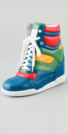 Today's So Shoe Me is the Lace Up Wedge Sneakers by Marc by Marc Jacobs, $320, available at Shopbop. Put a little pep in your step with these super saturated standout sneakers. Marc by Marc Jacobs is synonymous with carefree, fun and fashion-forward styles and these bright on bright hi tops are no exception.