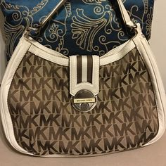 Michael Kors Shoulder Bag Beautiful Michael Kors Logo Shoulder bag, 100% authentic. Off white trim leather, canvas interior, with brown MK design. Bag is in very good condition, leather shows only some signs of wear. Great price. Michael Kors Bags Shoulder Bags