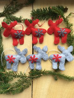 Felt ornaments are made of red and grey combination with hand made stitched detail and snowflakes. They are filled with polyester. Felt Christmas Decorations, Christmas Wreaths, Christmas Ornaments, Holiday Decor, Christmas Settings, Felt Ornaments, Red And Grey, Gift Bags, Christmas Time