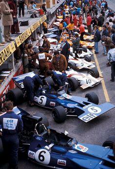 1971 Dutch Grand Prix Pit Lane by F1-N°. 6: François Cevert (FRA) (Elf Team Tyrrell), Tyrrell 002 - Ford V8 (RET) N°. 5: Jackie Stewart (GBR) (Elf Team Tyrrell), Tyrrell 003 - Ford Cosworth DFV V8 (finished 11th)