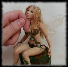 06_spring_fairy_sculpture_ooak__1_inch_head_by_halloweenpixie-d4rtpun.jpg (613×611)