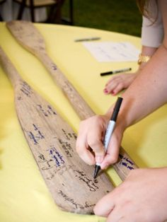 paddles for guest book. - because I wish I would have thought of this for my wedding!