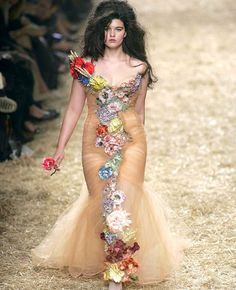 How could you not love this?  {Crystal Renn walking in the Jean Paul Gaultier in October 2005.}