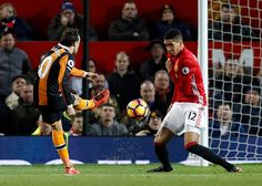 Hull City's Lazar Markovic has a shot blocked by Manchester United's Chris Smalling during the Premier League match at Old Trafford Manchester