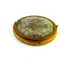 Vintage compact, with mirror, rouge and powder containers. $15.00, via Etsy.
