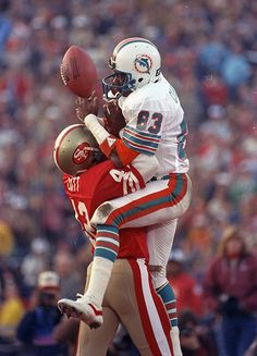 San Francisco 49ers' cornerback, Ronnie Lott (42). slams into Miami Dolphins' receiver, Mark Clayton (83), to break up pass during Super Bowl XIX on Sunday, January 20, 1985 at Stanford Stadium in Stanford, Calif. The 49ers won 38-16. (AP Photo)