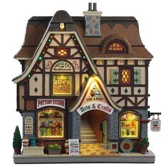 Lemax The Lanes - Arts And Crafts. SKU Released in 2019 as a Facade for the Caddington Village Collection. Christmas Village Collections, Christmas Village Accessories, Christmas Village Display, Christmas Village Houses, Christmas Villages, Miniature Christmas, Christmas Home, Christmas Ornaments, Christmas Crafts