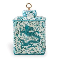 Scalamandre's iconic Chi'en Dragon pattern is depicted in turquoise on our porcelain tea caddy jar. Accented with a solid brass finial, the jar may be shown as a left/right pair as the pattern flips direction on the front and back. This vibrant tea caddy measures 16