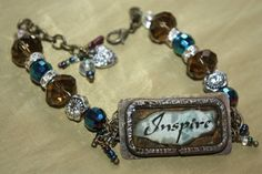 Inspirational resin bracelet upcycled soldered belt pieces  and burnt paper by CloverMoonDesigns on Etsy