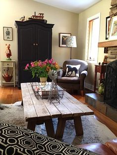 what a great idea! two picnic table benches side by side make the perfect sized coffee table.