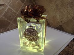 SPECIAL ORDER COPPER CHRISTMAS ORNAMENT, WITH COPPER/BRONZE RIBBON EMBELLISHMENT AND WARM LED BATTERY OPERATED LIGHTS. LASER ETCHING BY LAVENE & CO.