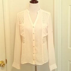 Off white blouse from Francesca's Beautiful off white blouse from Francesca's . Only worn twice. Has pretty lace detailing. Sleeve can be rolled up (shown in picture). Dry cleaned Tops Blouses